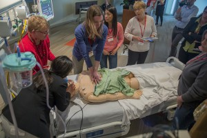 Clinicians practicing CPR on Manikin in Jump Auditorium