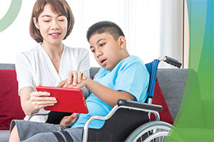 Health care worker assisting child with special needs